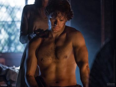 Claire tending Jamie's wounds.